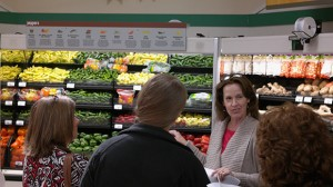 Janie Cole gives a tour at a local grocery store