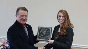 Dean Velmer Burton presents Susan Shea with the award.