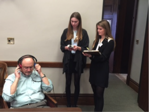 Students screen a legislator's hearing.