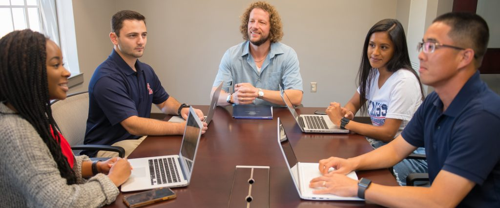 Department Chair, Dr. WEsley Jennings, meets with four students