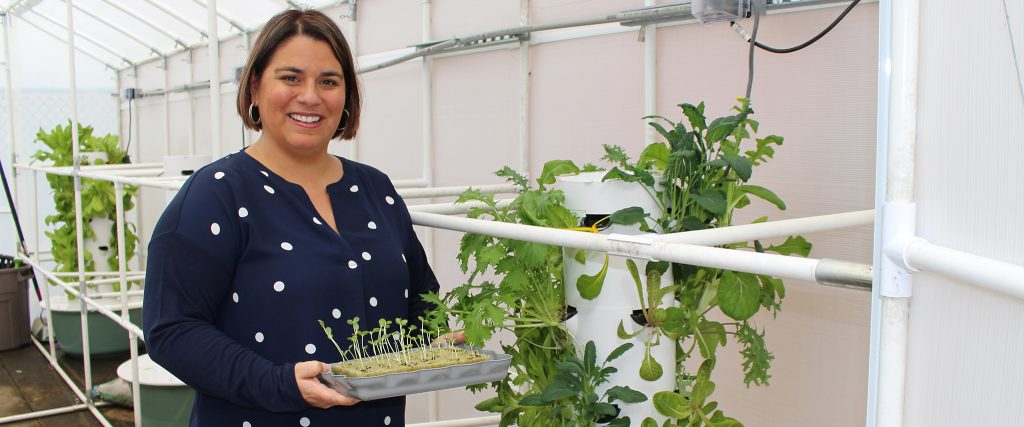 Graduate Student Lends a Green Thumb for Families in Need